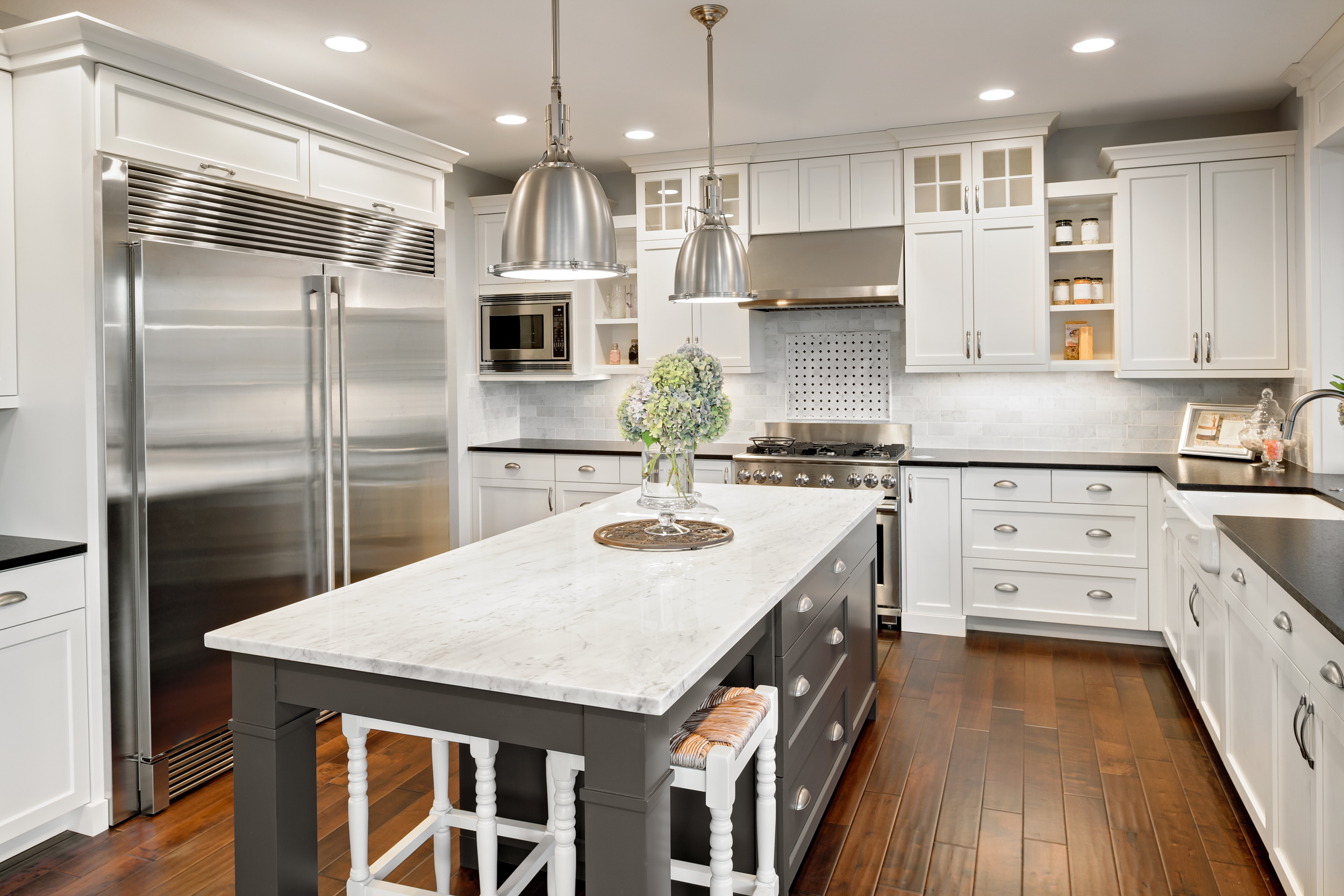adobe kitchen island with white cabinets